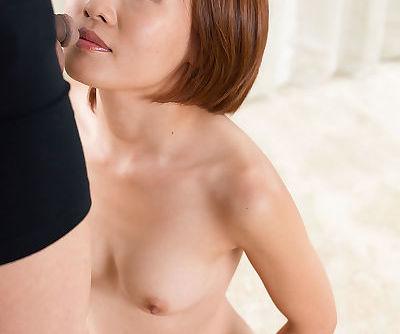 Nude Asian female sucks a cock on..