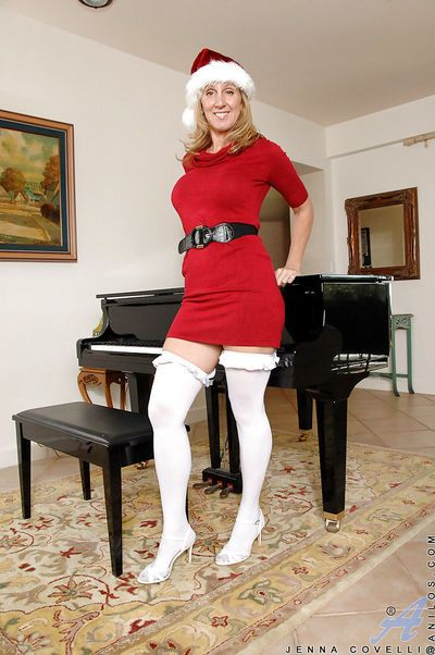 Juggy mature blonde gets rid of her Christmas outfit and white lingerie
