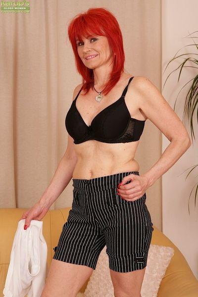 Older redhead Amanda Rose undressing for masturbation of hairy pussy