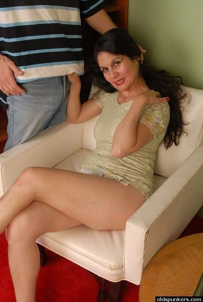 Mature Latina woman Carmen giving a blowjob while flaunting shaved cunt
