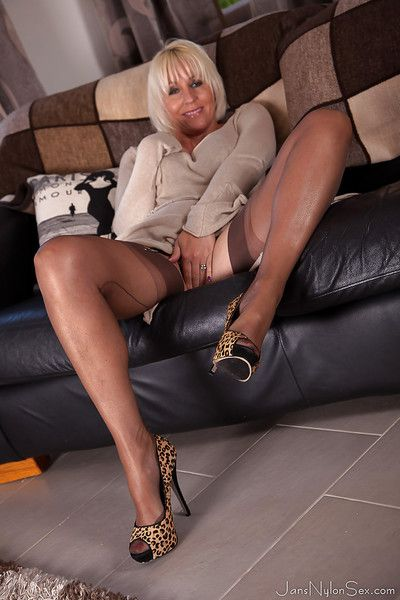 Mature blonde woman Jan Burton posing non nude in granny pants and hose