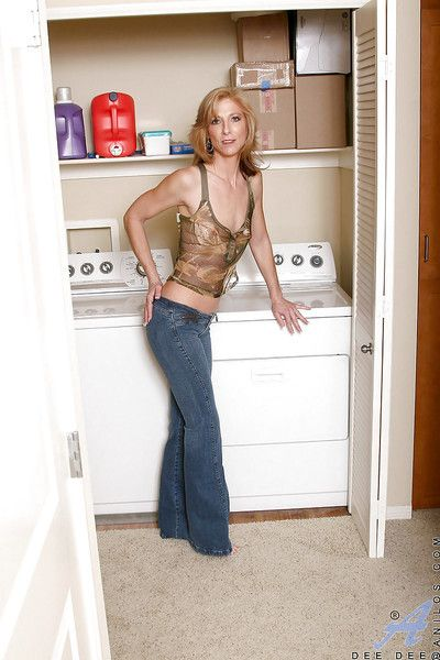 Mature vixen Dee Dee with tiny tits strips her tight jeans.