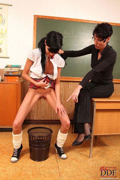 Cute schoolgirl in glasses spanked by her fetish crazed mature teacher