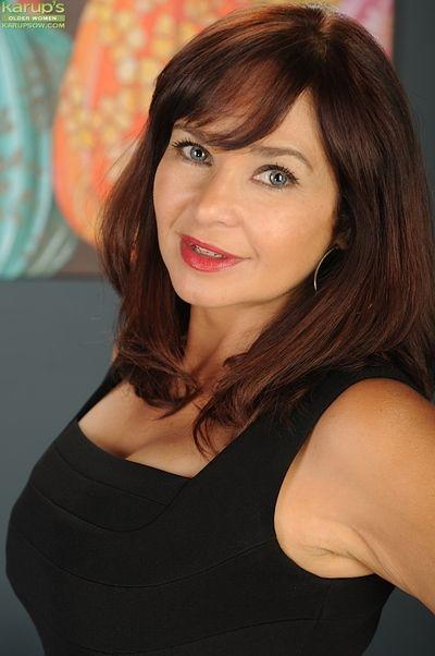 Natasha Oliwski shows off her mature ass in sexy black panties