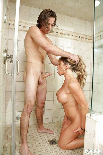 Busty MILF Farrah Dahl kneels to suck heavy cock in the shower - part 2