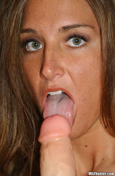 Overexcited shaved milf sucking on the biggest of her toys