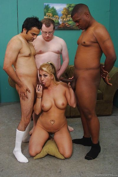 Busty mature slut enjoys interracial foursome with hung lads