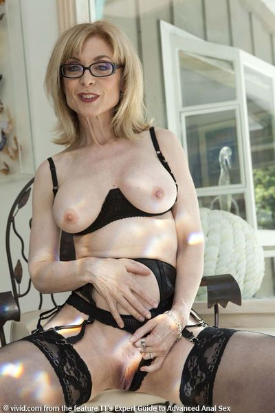 Top mature pornstar Nina Hartley plays with her horny pussy in black lingerie