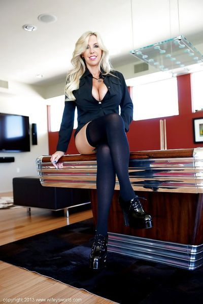 Stunning housewife in black stockings performs a steamy posing scene
