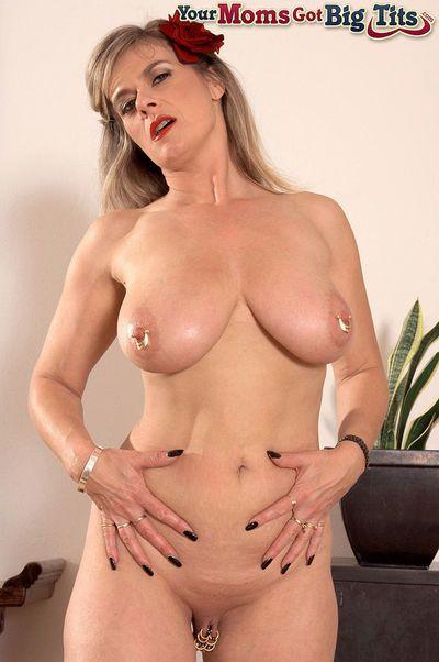 Bosomy mature housewife Marina Rene stuffs her pierced twat with a red dildo