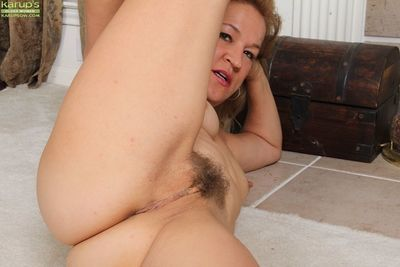 Experienced lady Sabina Wexler spreads legs to expose hairy pussy