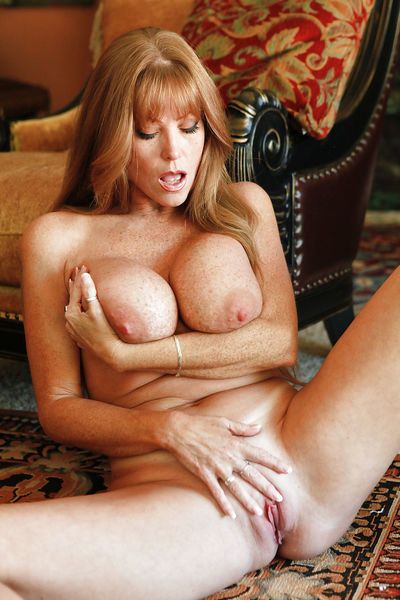 Freckled mature stunner with massive boobs Darla loves stripping down