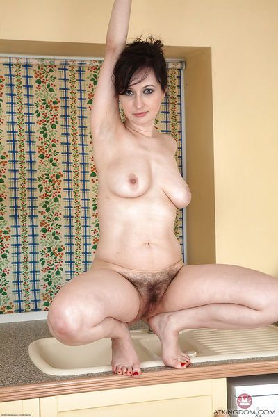 Chubby mature lady Nikita showing off hairy pussy on kitchen counter top