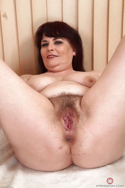 Chunky mature lady Christina X undresses for hairy cunt exposure