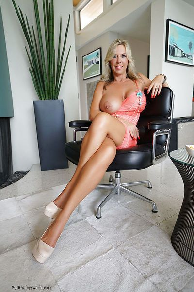 Platinum blonde wife Sandra Otterson letting huge breasts loose from dress