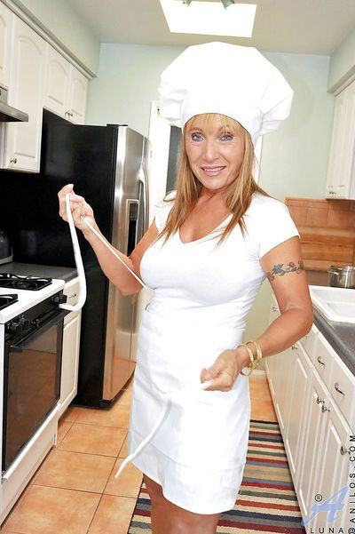 Sexy mature cooking and masturbating with a dildo in the kitchen