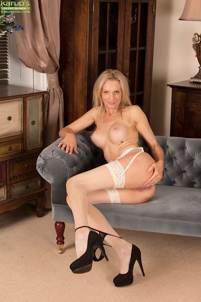 Blonde mature Angel P. reveals her tight ass in sweet stockings
