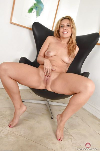 Aged blonde Stevie Lix spreading ass cheeks and shaved pussy in boots