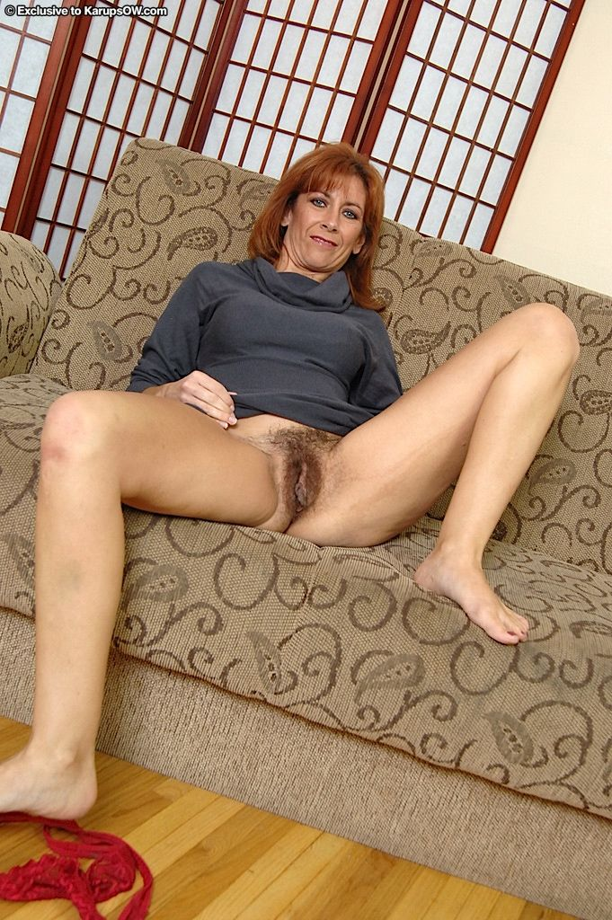 Lusty redhead mature gal undressing and toying her shaggy gash