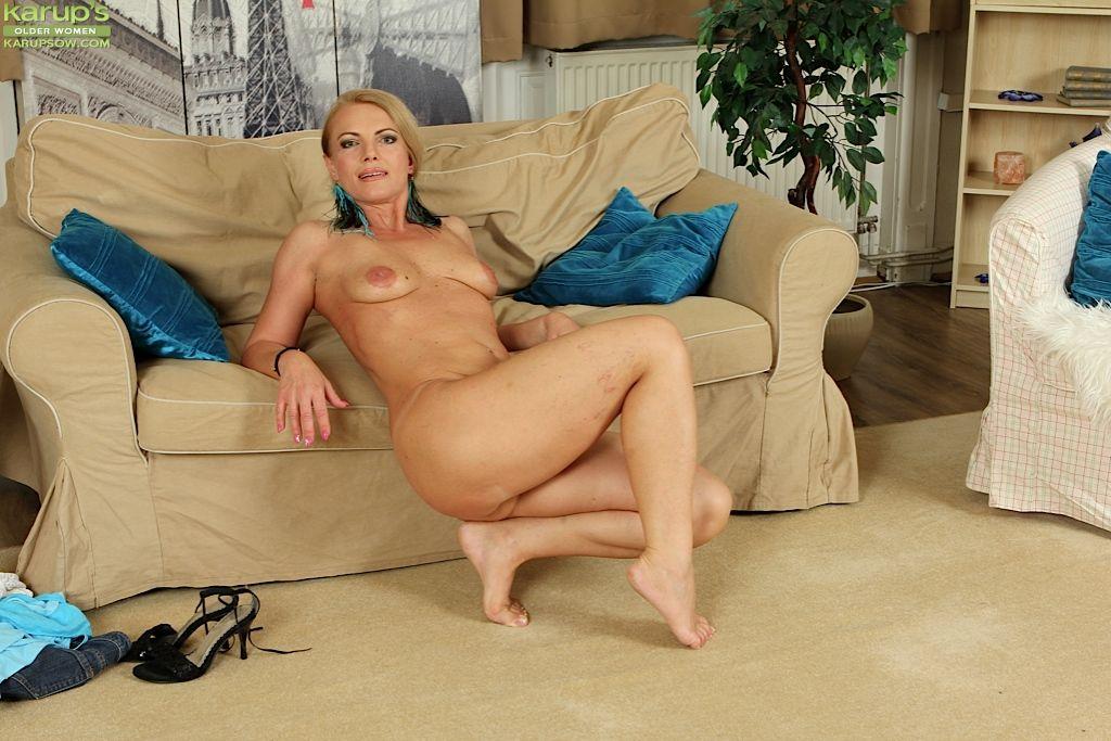 Barefoot blonde mom Sharon Foldhart sliding white underwear down long legs