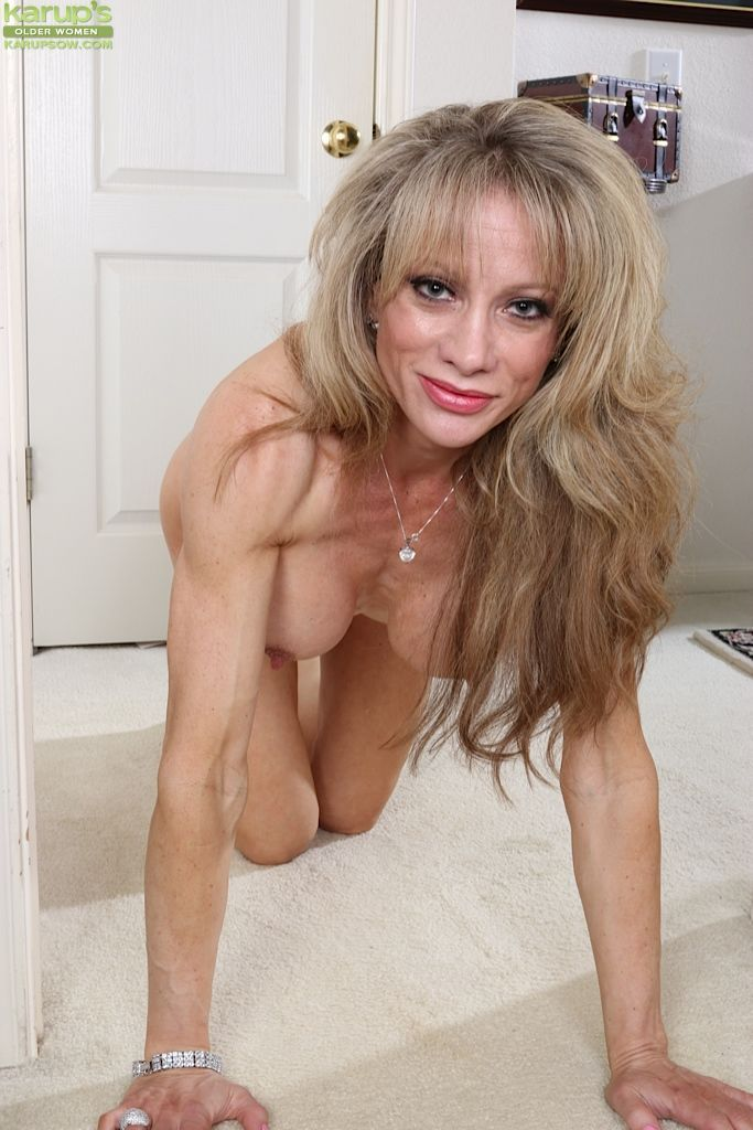 Older woman Christina Brim posing non nude in long dress and heels - part 2