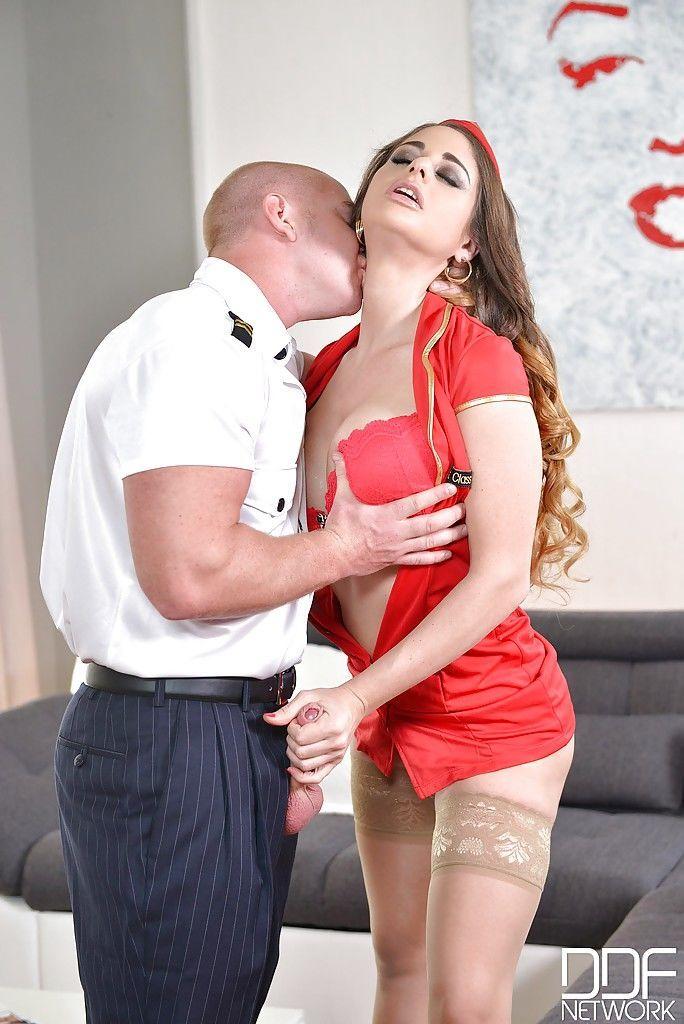 Busty Euro MILF Cathy Heaven deepthroating cock in uniform and hose