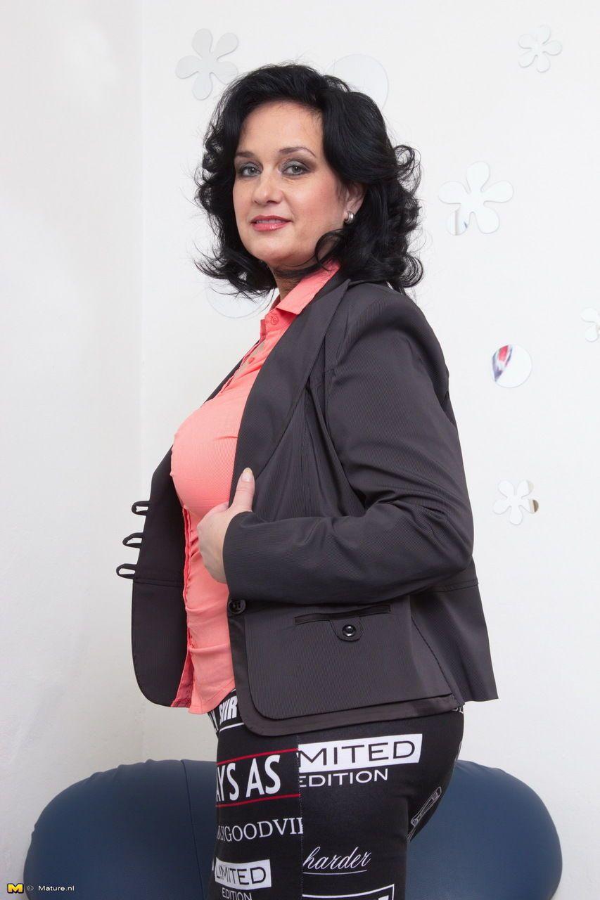 Mature woman flashing white upskirt underwear wearing black stockings