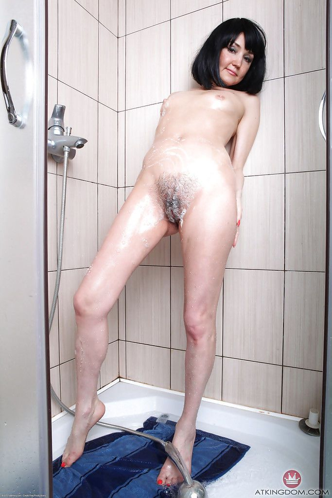Matilda pleases herself in the shower with romantic solo fingering