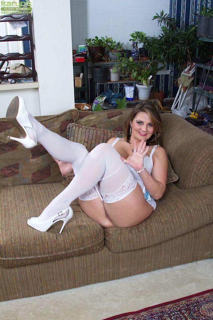 Tattooed mature Cherrie Dixon undress her white lingerie so hot