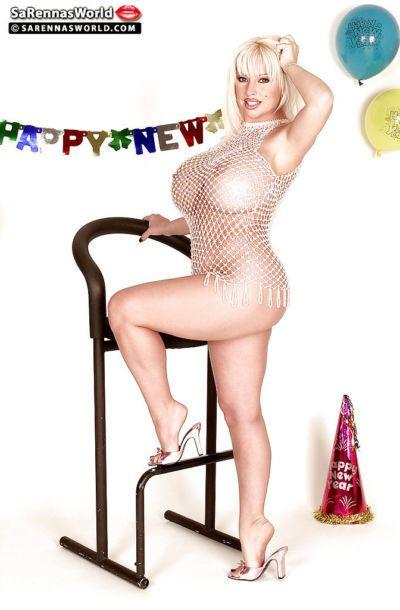 Mature pornstar SaRenna Lee freeing massive tits from mesh top
