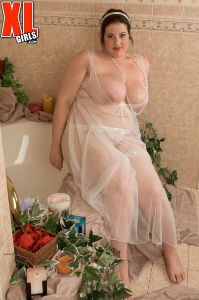 Fat female Angel Sin climbs into bathtub wearing a sheer dress