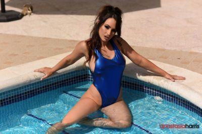 Hot brunette model Anastasia Harris sets her natural tits free from swimsuit
