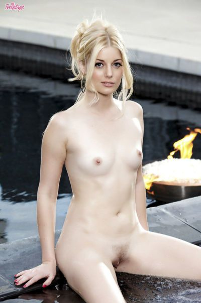 Admiraable blondie with pale skin posing nude in the pool