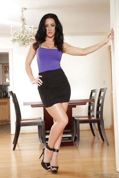 Gorgeous knockout in tight-fitting dress uncovering her ravishing curves
