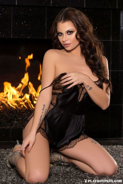 Hot centerfold model Shelly Lee slips off her sexy black lingerie