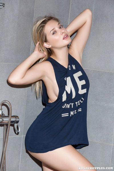 Centerfold blonde with big all natural breasts gets wet in shower