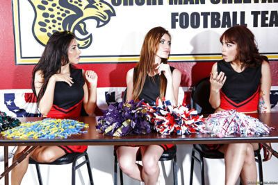 Lesbian cheerleaders having fun featuring August Ames and Emma Stoned