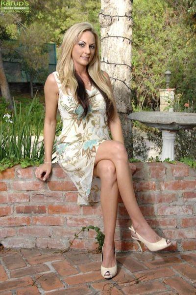 Big tits milf Sindy Lange enjoys taking off her panties while outdoor