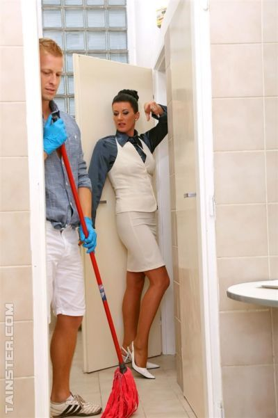 Clothed lady in pantyhose and janitor play water sport games in bathroom