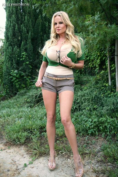 Busty belle Kelly Madison lets her big tits hang out in the fresh air