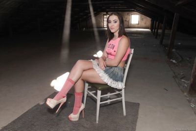 European babe Zoe Doll strutting in skirt and socks before spreading pussy