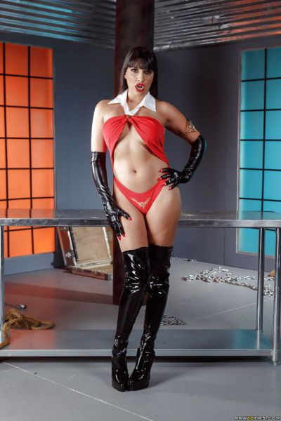 Latina Mercedes Carrera modeling in long boots and gloves with vampire teeth