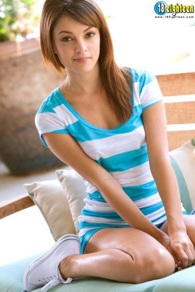 Cute teen Ashley Doll makes her nude modelling debut on bench outdoors