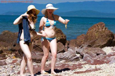 Lesbians Chloe B and Sue-Ann strip off their bikinis at the beach