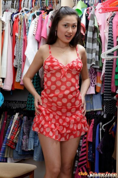 Asian teen gets horny while clothes shopping & vibrates her clit in the store