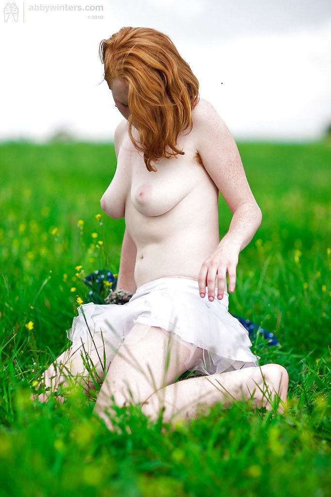 Redheaded amateur chick Isadora showing off hairy muff and armpits outdoors