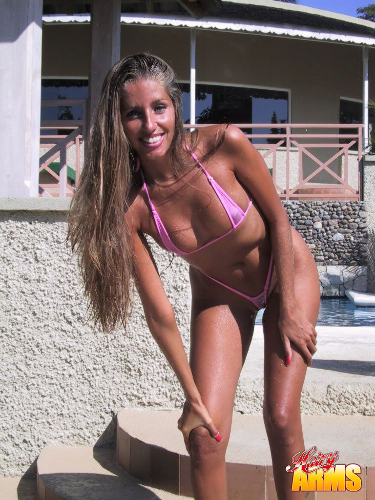 Amateur chick Lori Anderson pulls her bikini aside to catch rays on tiny tits