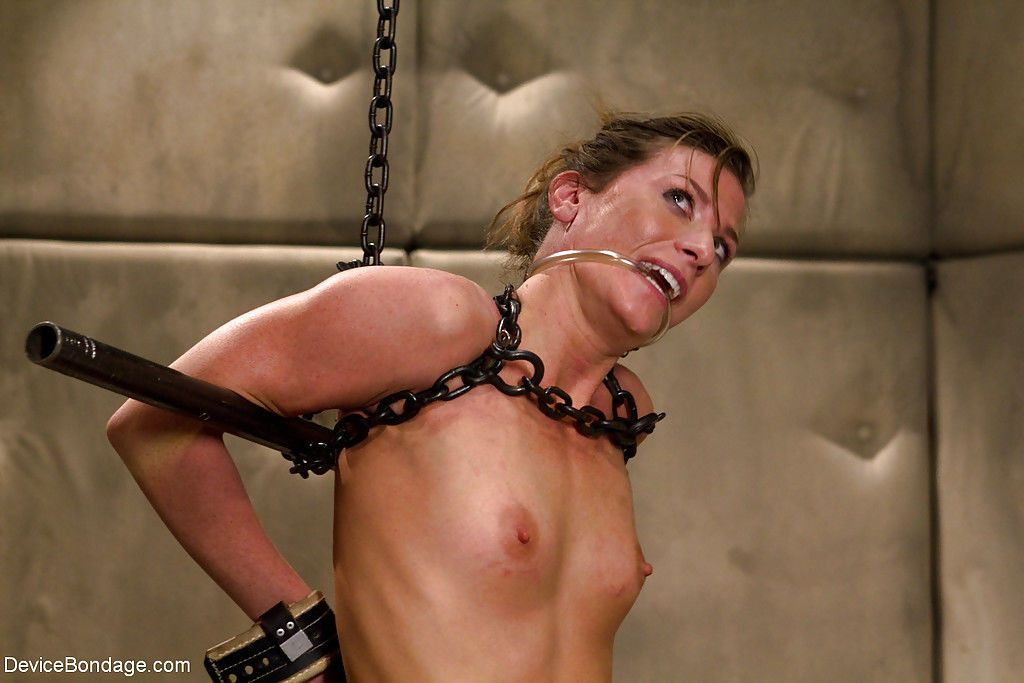 Skinny chick Ariel X and her bald vagina struggle in chains