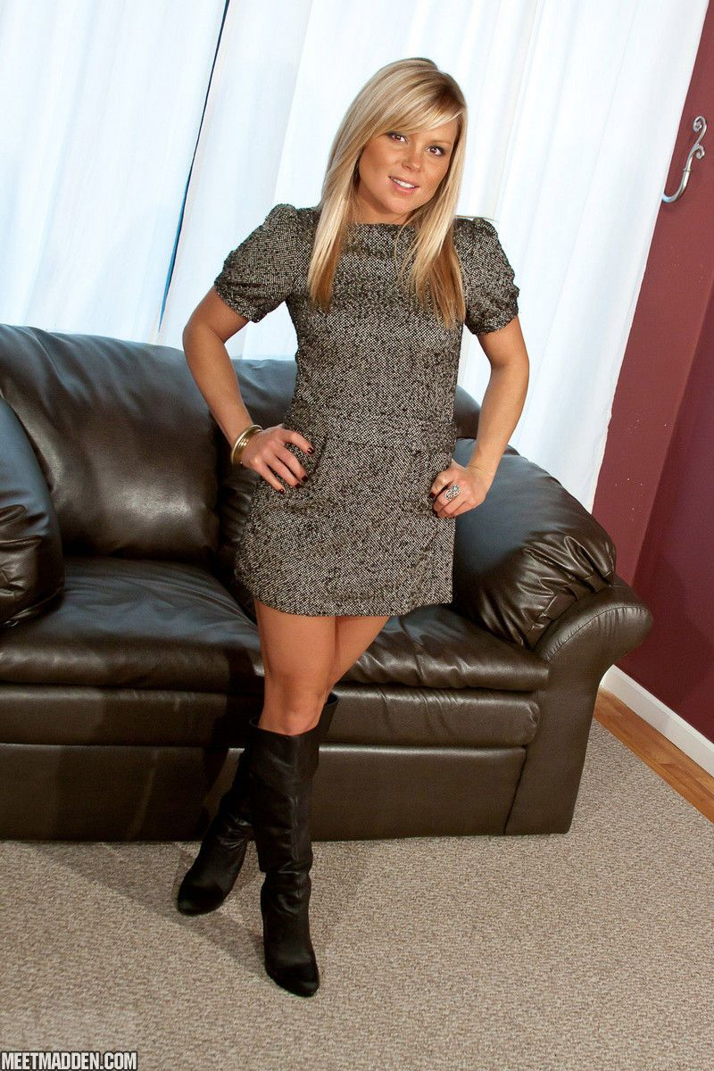 Clothed amateur Meet Madden teases while stripping down to bra and boots
