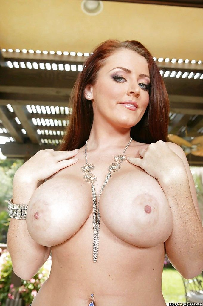 Pornstar redhead babe Sophie Dee shows her sexy tits outdoor